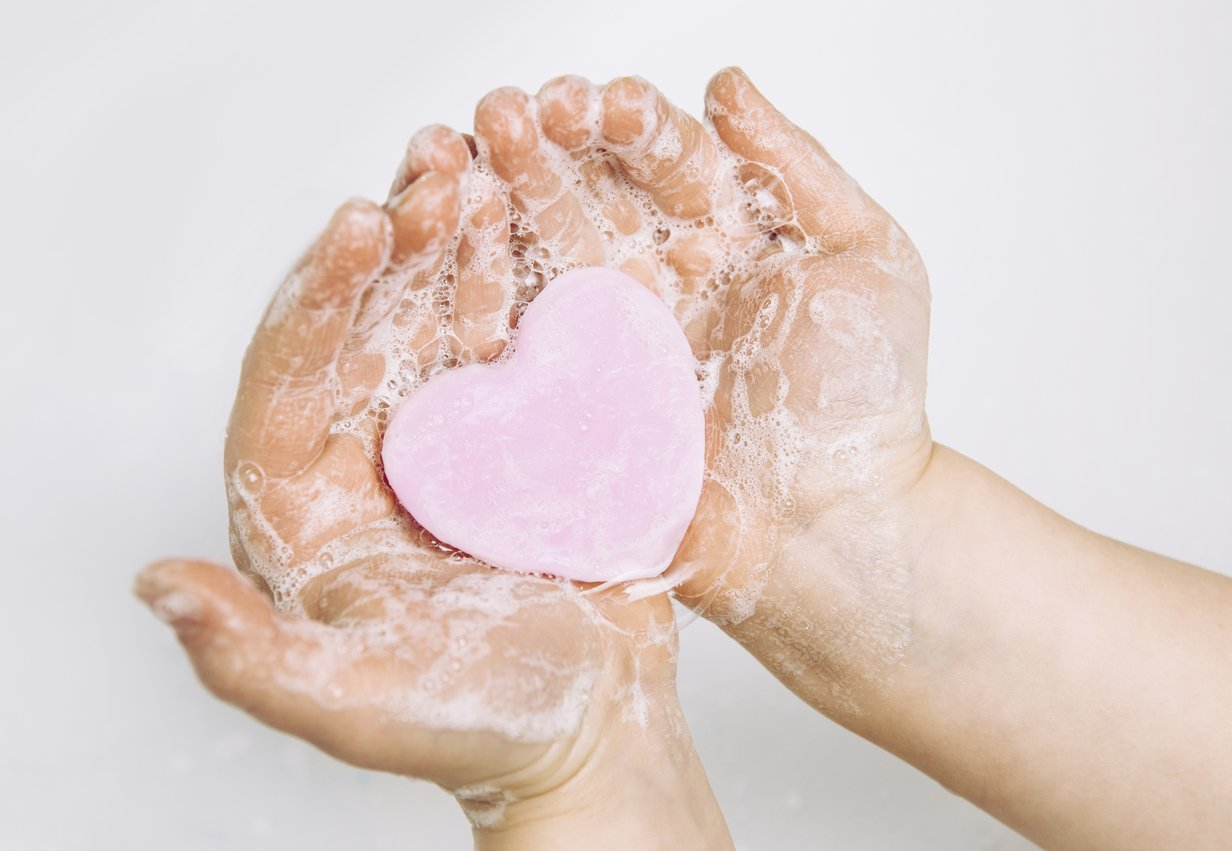 soapy hands holding heart