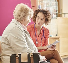staff assists patient in billing