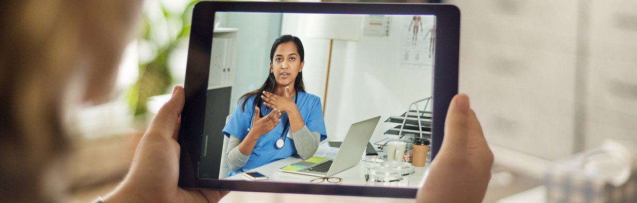 person speaking with physician through video visit