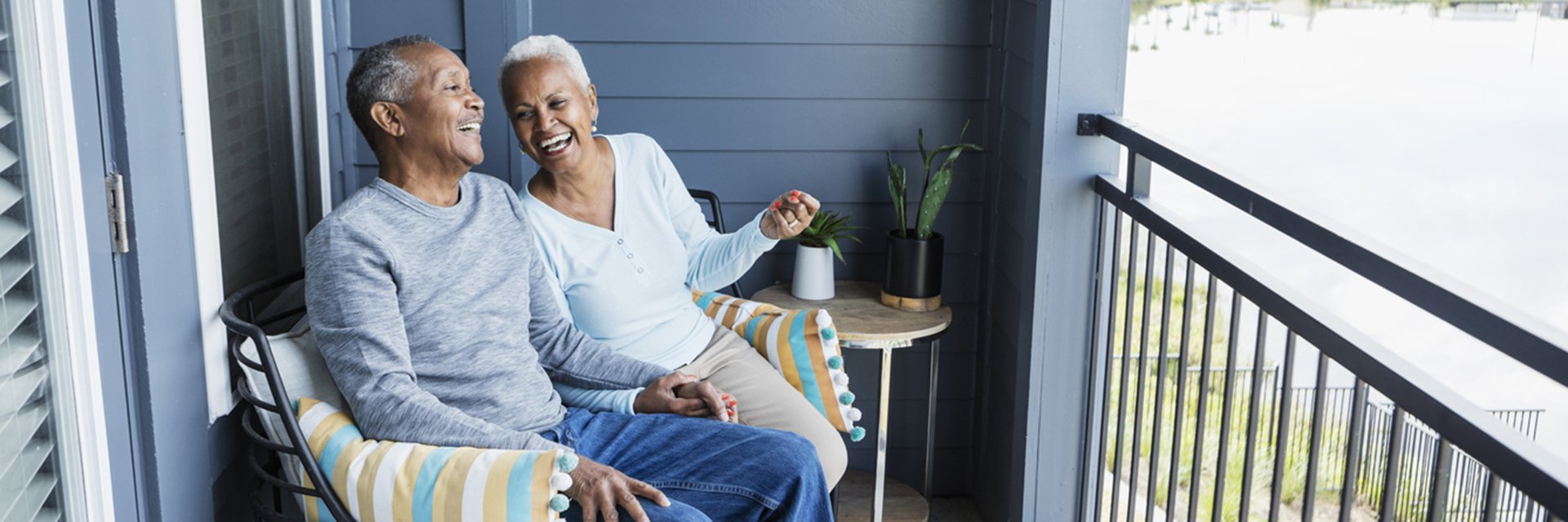 couple smiling and sitting on porch