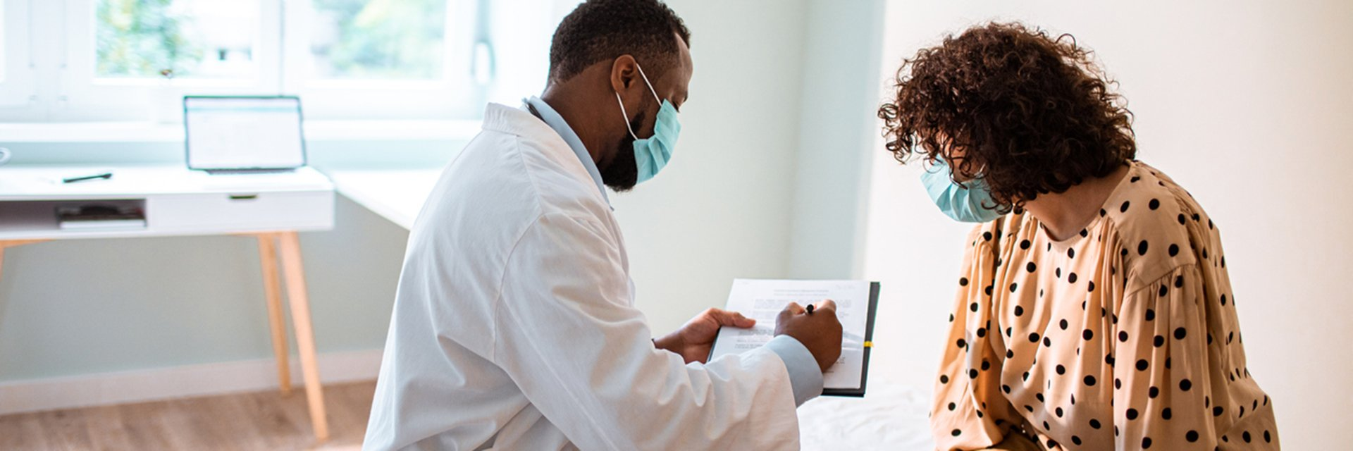 doctor reviewing chart with patient in office
