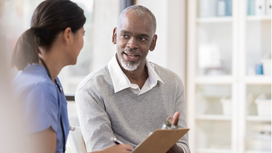 Male patient speaking with physician
