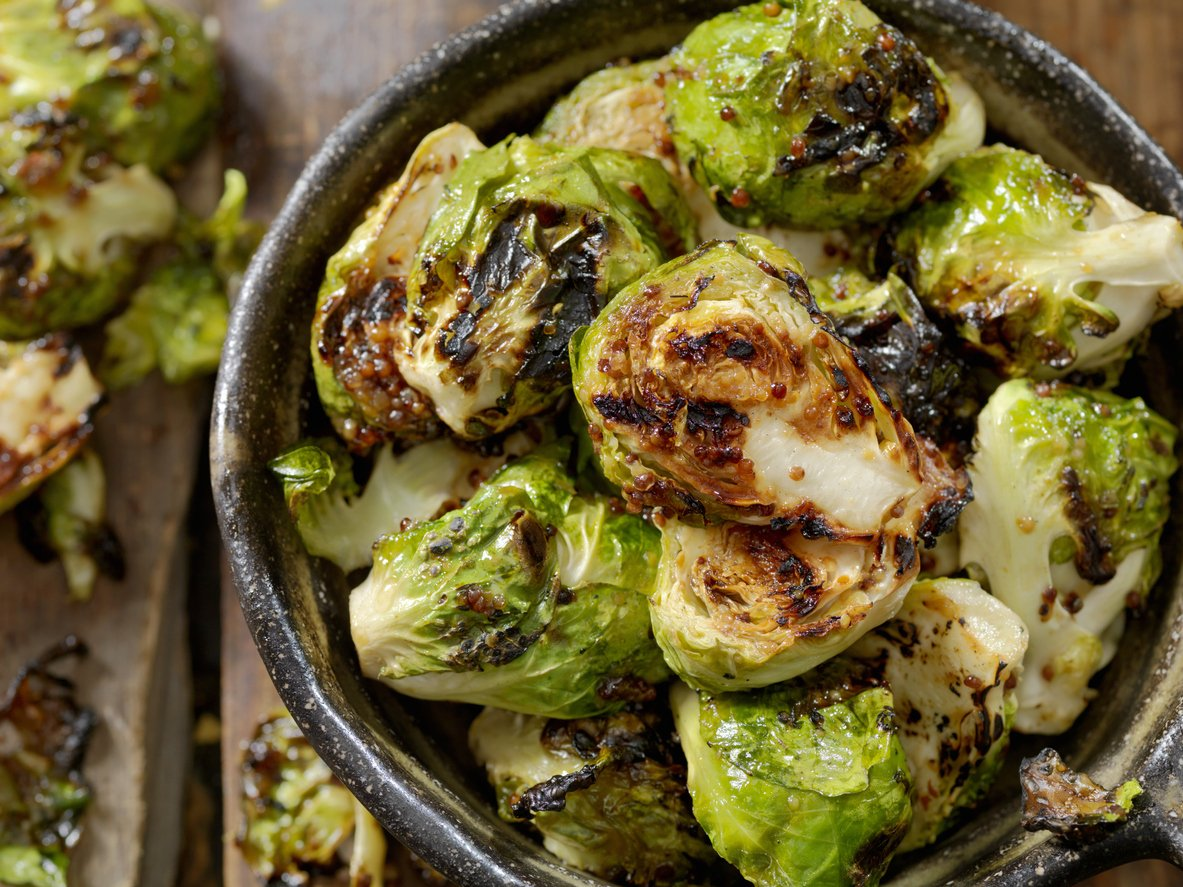 Brussels Sprouts in bowl with mustard dressing