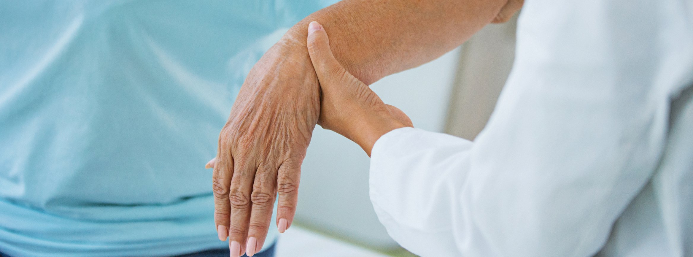 doctor holding patient wrist