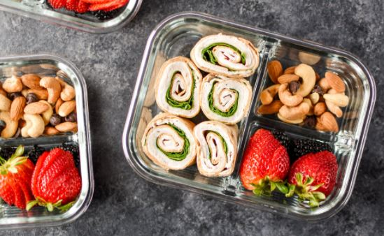 Turkey pinwheels served with healthy snacks